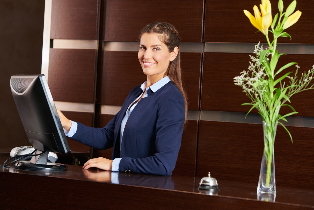 bigstock-Friendly-concierge-at-hotel-re-181500331