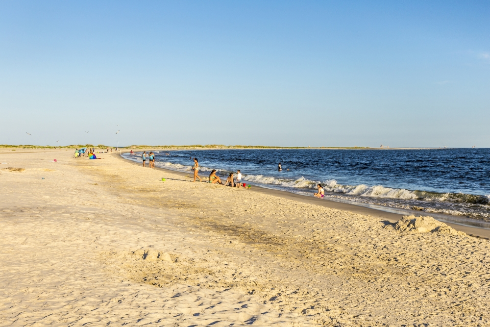 bigstock-People-Enjoy-The-Beautiful-Bea-80847011